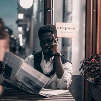 black-man-reading-a-newspaper-3473492